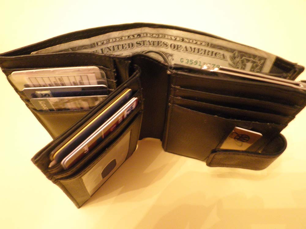 Wallet with a dollar bill in it