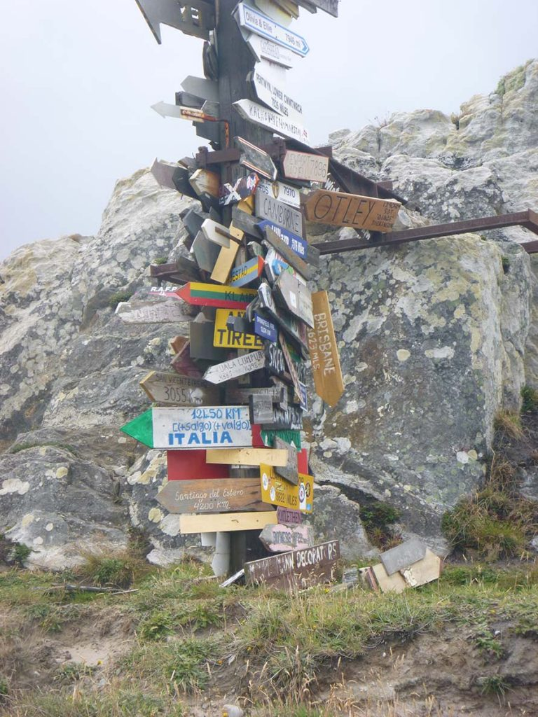 signs on a post on Falkland Island