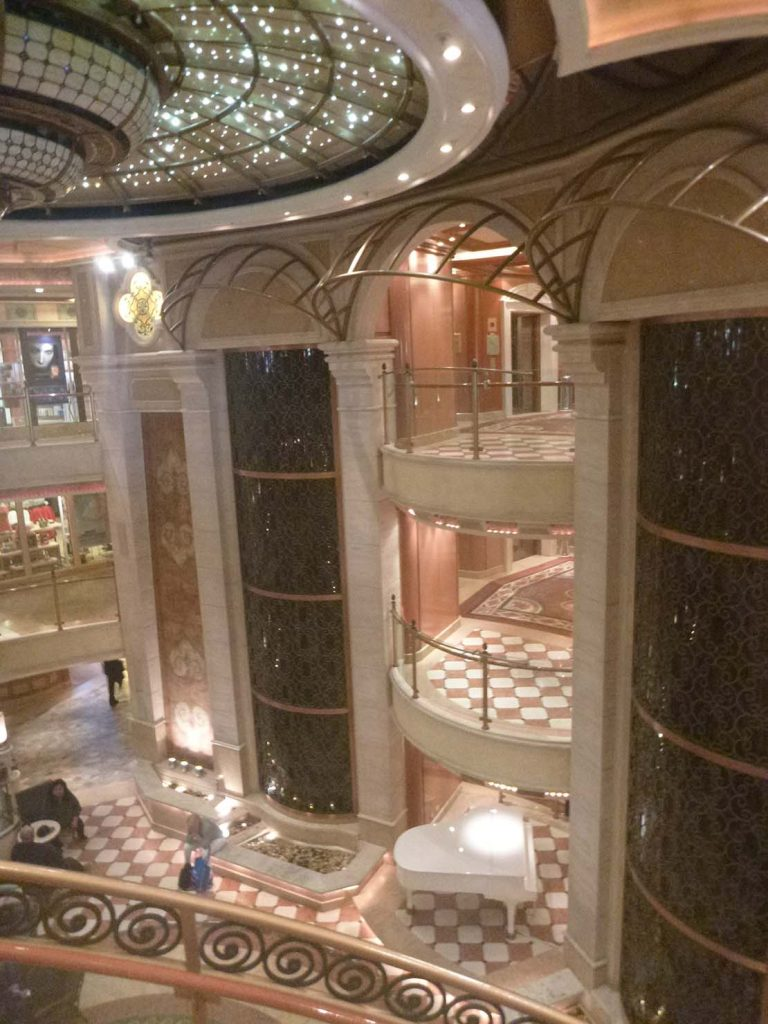Weird travel incidents my camera fell from the top balcony of the cruise ship atrium hit a man on the head and bounced off