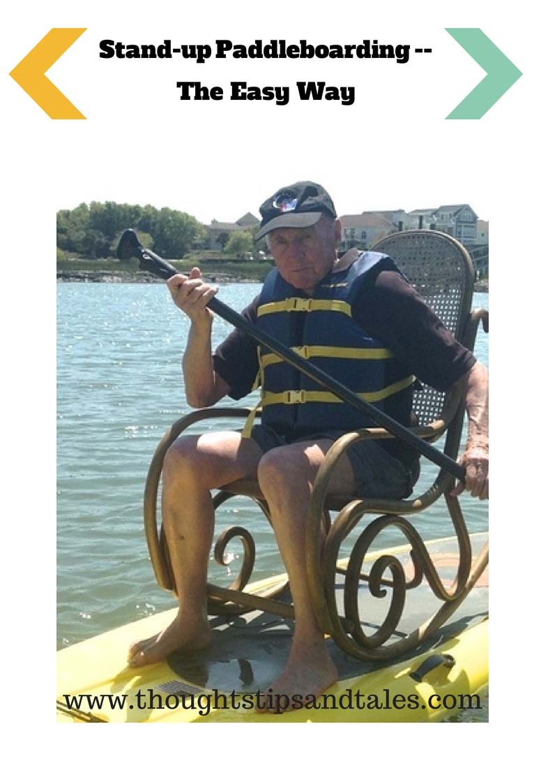 Man sigting on stand-up paddleboard in a rocking chair