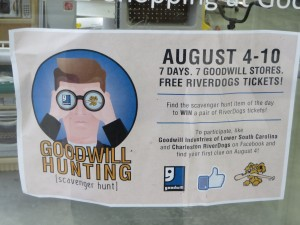 "Sign on Goodwill store door that announces ""Goodwill Hunting""contest"
