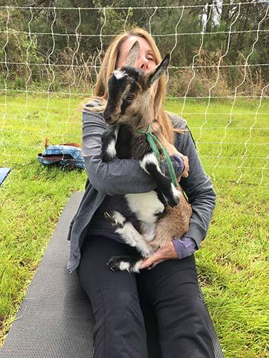 Goat Yoga holding baby goat2